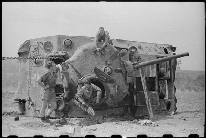 New Zealanders working on a recaptured tank, World War II, Italy - Photograph taken by George Kaye