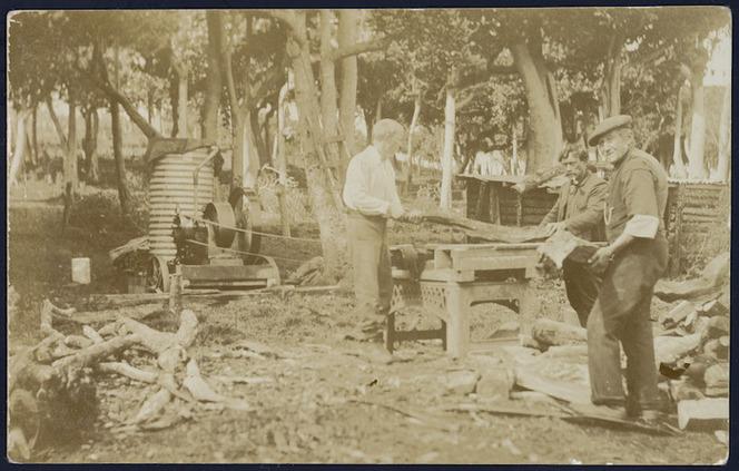 Noel Cox, George Rewai, and Felix Cox, cutting firewood, Chatham Islands