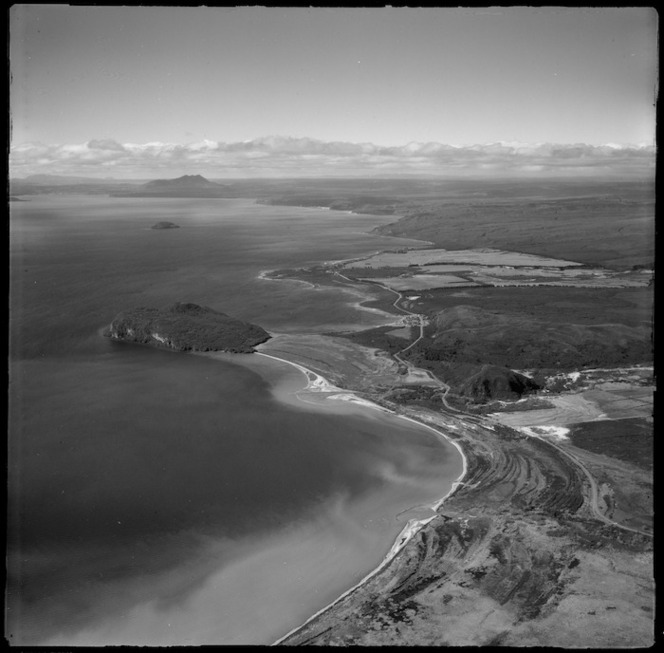 View of eastern side of Lake Taupo with Stump Bay and the Motuoapa Peninsula, with State Highway 1 and the settlement of Motuoapa to Motutaiko Island beyond,