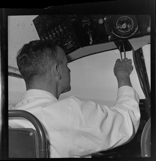 Unidentified co-pilot in cockpit of Tourist Air Travel aeroplane