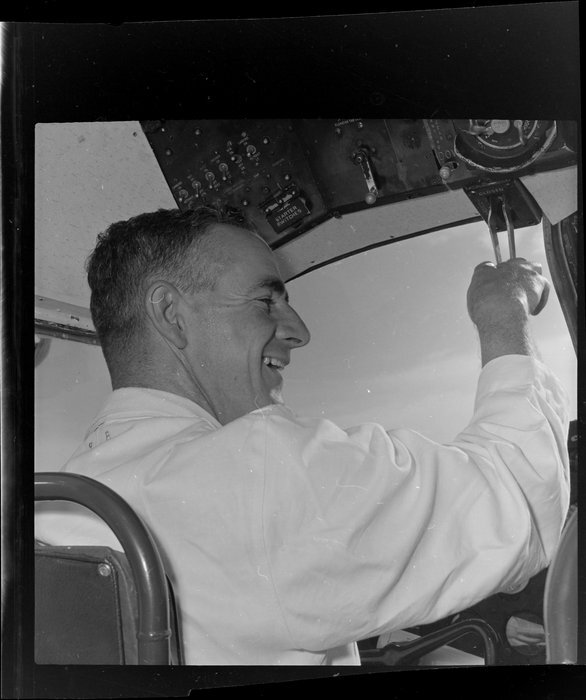 Unidentified pilot in cockpit, Tourist Air Travel