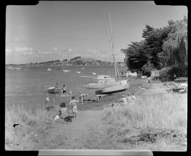 Beach at Onehunga, Auckland, people enjoying themselves in the water