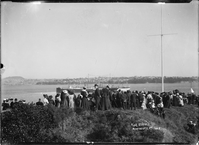 Crowd gathered round the flagstaff at Northcote, Auckland