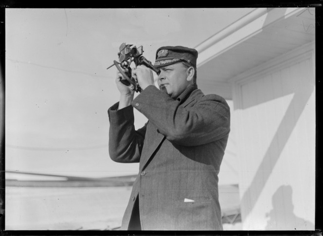 An unidentified naval officer using a sextant