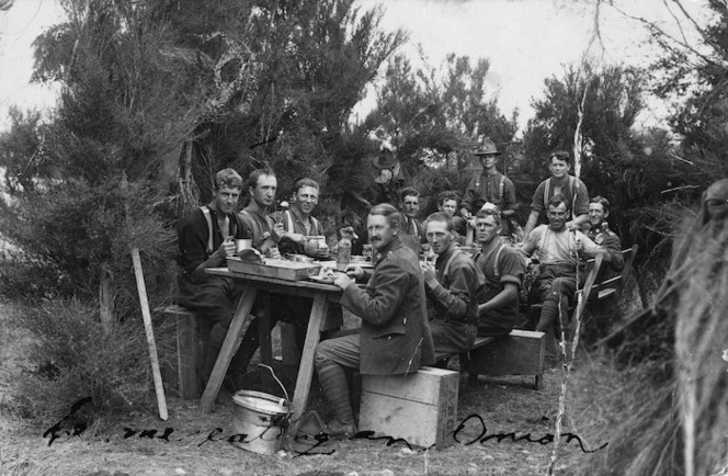 New Zealand soldiers dining in the bush