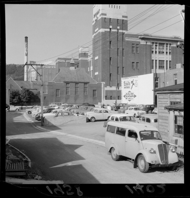 Cars parked off Tory Street, Wellington, Bryant & May building in the background