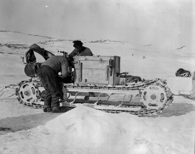 Bernard C Day and W Lashly fixing up one of the motor vehicles, Antarctica