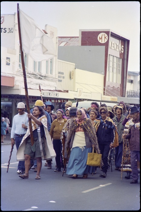 Tame Iti holding pou whenua, accompanied by Whina Cooper, leading Maori Land March along Hamilton street