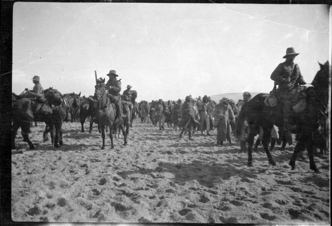 Soldiers of the ANZAC Mounted Division with Turkish Prisoners