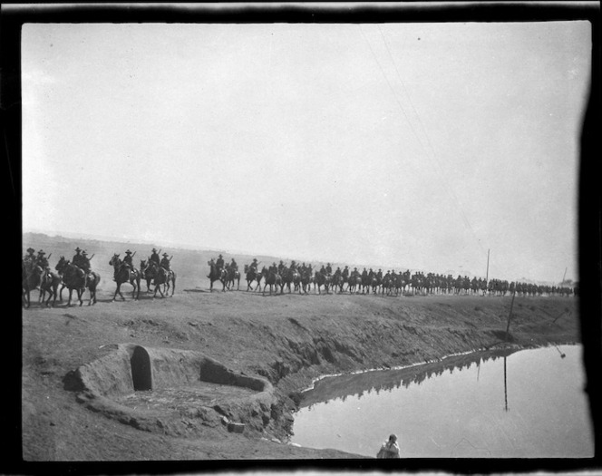 Mounted soldiers riding along the embankment of the Suez Canal