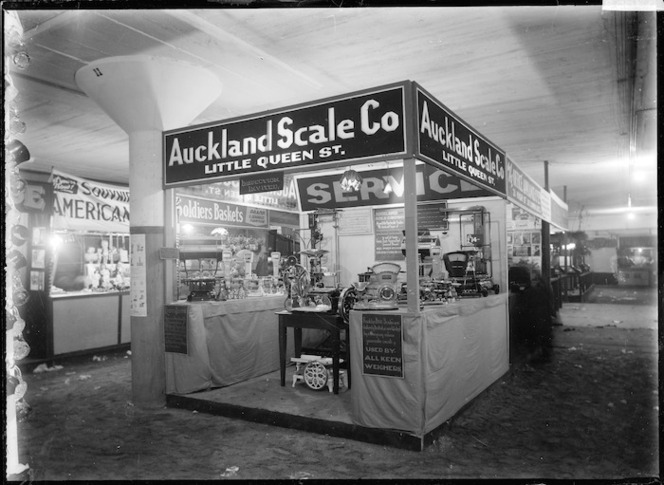 A stand at a trade fair in 1930, advertising the Auckland Scale Company, Little Queen Street