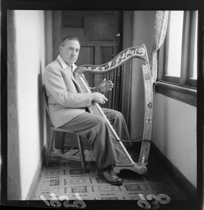 Mr Rupert George with his home-made Irish harp, 1959