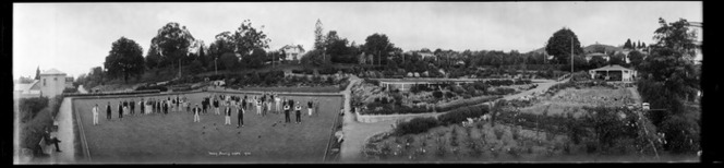Nelson bowling green, taken 1924, showing members on the green and the clubhouse at right rear, Ref: Pan-0158-F
