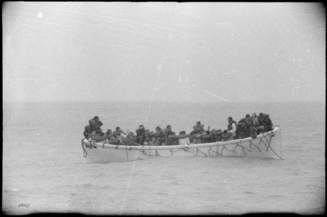 Survivors from the Wahine shipwreck in a lifeboat, Wellington. Taken by an unidentified Evening Post staff photographer Ref: 35mm-01152-29-F