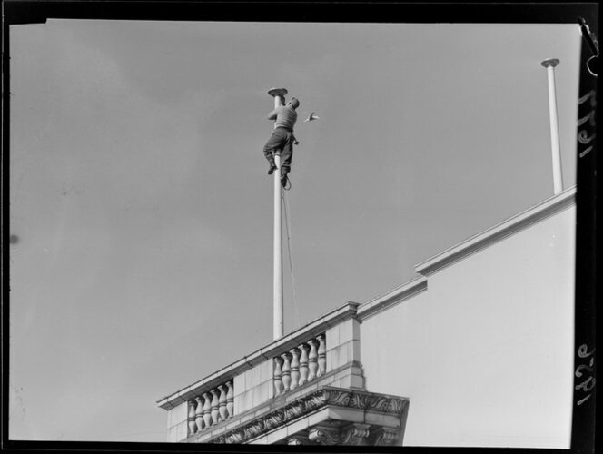 Man fixing a flagpole, 1956