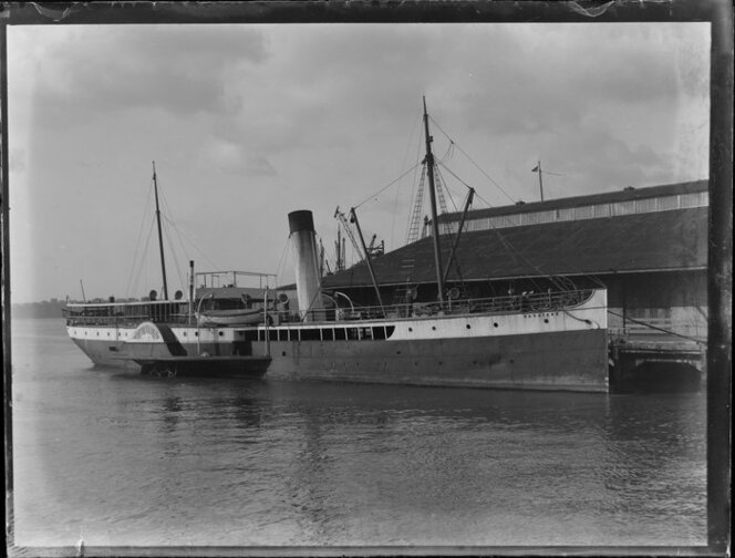 Northern Steam Ship Company Limited paddle steamer Wakatere moored at wharf, location unknown