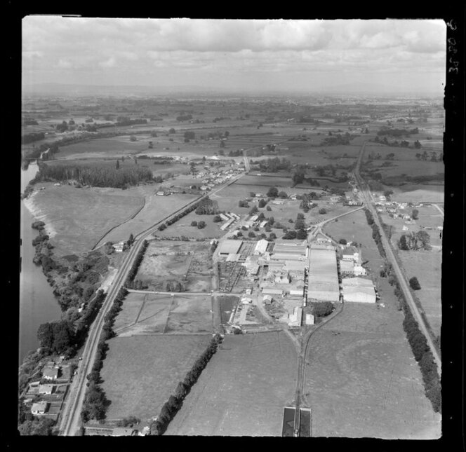Horotiu, Waikato, showing AFFCO Freezing Works next to the Waikato River and Great South Road (State Highway 1) with farmland beyond