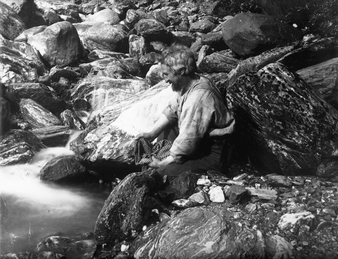 Harper, Arthur Paul, 1865-1955 :Charles Edward Douglas, washing his shirt in a glacial river