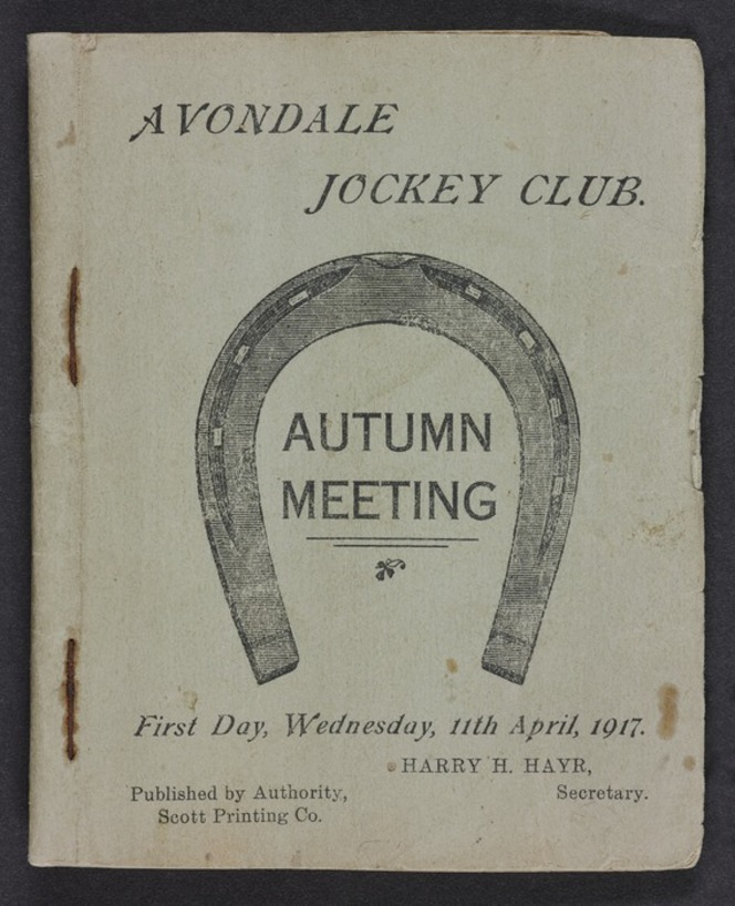 Racing programme shows an engraving of a horseshoe on the front cover.
