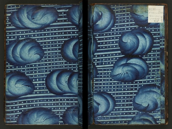 Blue paste endpaper. Blue paste has been spread in lines and then swirled to form the pattern.