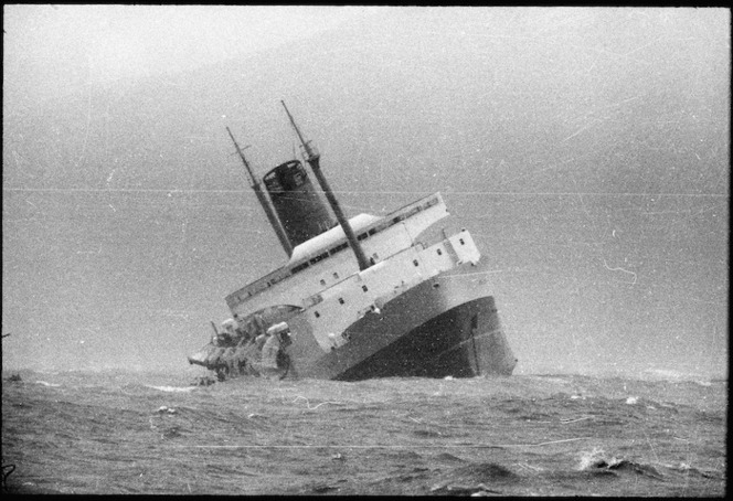 The ship Wahine sinking in Wellington Harbour. Taken by an unidentified Evening Post staff photographer<br> Ref: 35mm-01149-29-F