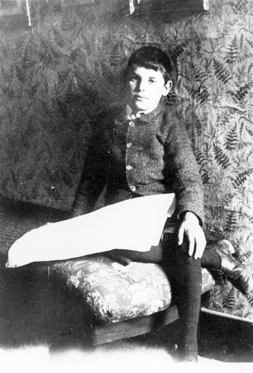 Image: Boy sitting on a chair