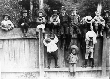 "Image: Photograph: Twelve children sitting on a fence at ""Te Rakaunui"", Greytown"