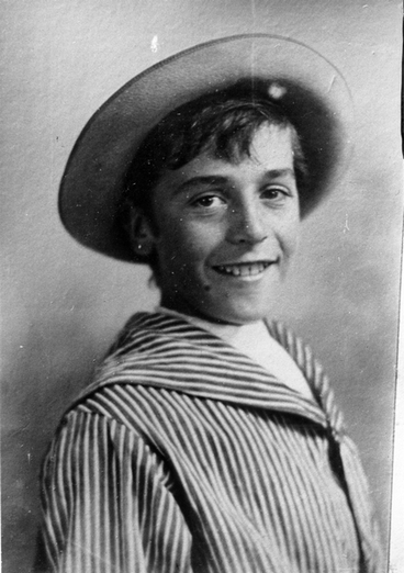 Image: A boy in a hat and a striped sailors style shirt