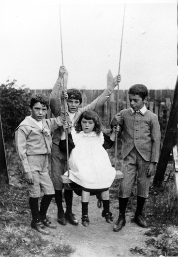 Image: Four children by a swing