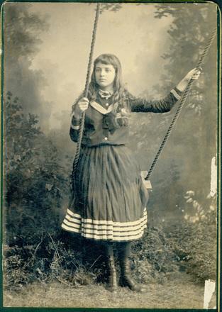 Image: [Young girl on swing]