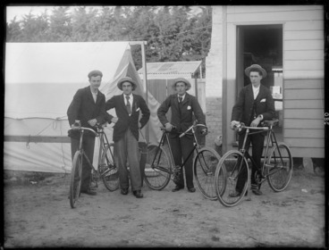 Image: Four unidentified men wearing hats, with bicycles, probably Christchurch district