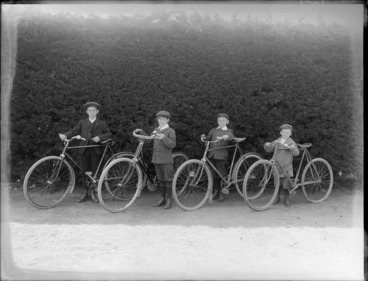 Image: Four unidentified boys with bicycles, probably Christchurch district