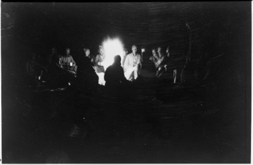 Image: LRDG patrol members sitting around a campfire on the Libyan Sand Sea