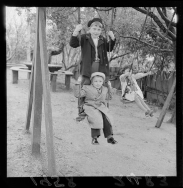 Image: Unidentified Russian children playing on the swings at the Russian Embassy, Wellington