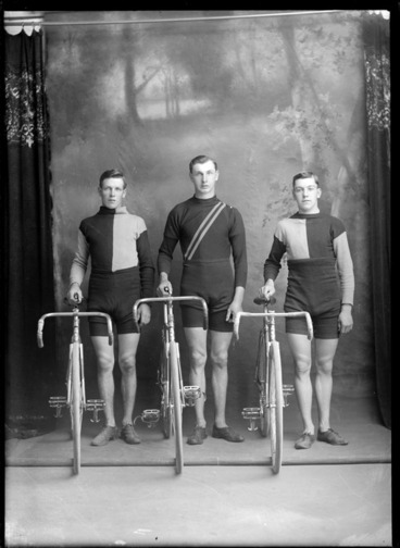 Image: Studio portrait of three unidentified male cyclists, in uniform with racing bicycles, probably Christchurch district