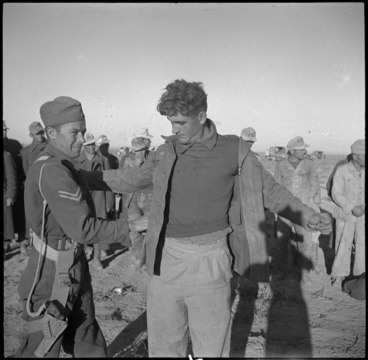Image: NZ intelligence staff searching prisoners in the Western Desert, World War II