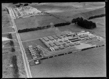 Image: Egmont Box Company factory with saw mill and stacked lumber, with another lumber yard and workers housing beyond, Tokoroa, Waikato Region