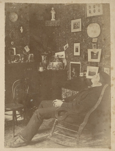 Image: Room interior with young man in a rocking chair