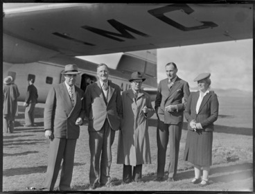 Image: Unidentified group of men, including a woman, standing by a Bristol Freighter aircraft, Kaikohe