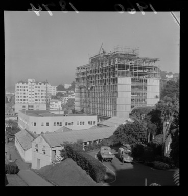 Image: View of the new Government Buildings under construction on Bowen Street behind Parliament Building with Broadcasting House in front, Wellington City