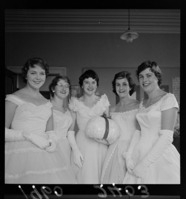 Image: Group portrait of debutante girls in evening dresses with lucky snowball for the Plunket Ball, probably Wellington Region