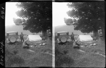 Image: Edgar Williams by campfire and unidentified man by tent, unknown location