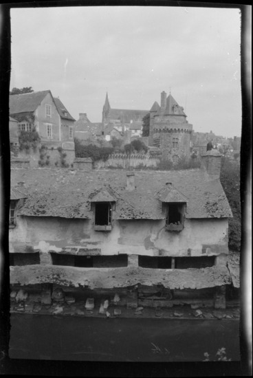 Image: Elevated view of a house with a shingled roof, and river along the ramparts, with buildings beyond, Vannes, Brittany, France