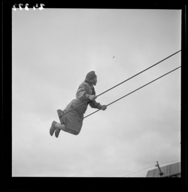 Image: Girl playing on a swing at a Polish refugee camp in Pahiatua