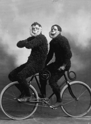 Image: Members of the Invercargill Cycling Club riding a bicycle in monkey costume