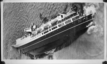 Image: Aerial view of the wreck of the Wahine, lying on its side in Wellington Harbour
