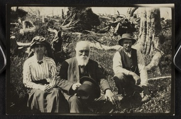 Image: Lady Anna Paterson Stout, Sir Robert Stout, and an unidentified man sitting on a bank