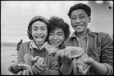 Image: Three boys holding toheroa, Hokio Beach.