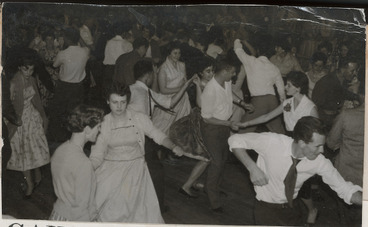 Image: Young men and women rock and roll dancing