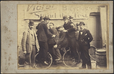 """Image: Four men on a """"Victor"""" bicycle, Wellington."""